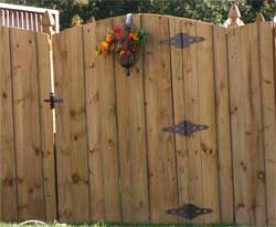 wooden arched fence gate